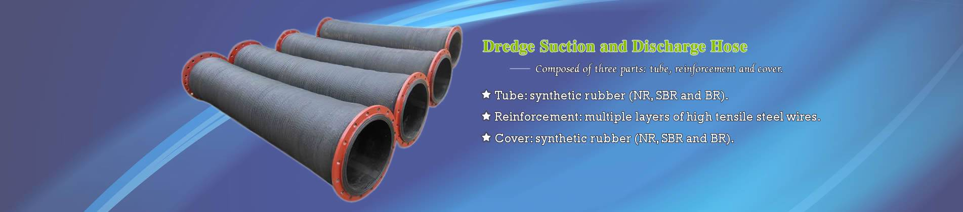 Four dredge suction and discharge hoses of large diameter.