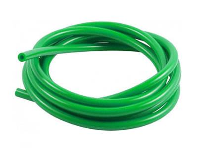 A roll of green color opaque PVC garden hose on the white background.